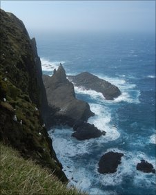 Steep cliffs and wild waters of Faroe Islands