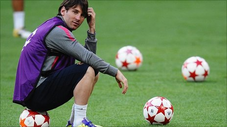 Lionel Messi sits on a ball during a break as Barcelona train at Wembley ahead of the Champions League final