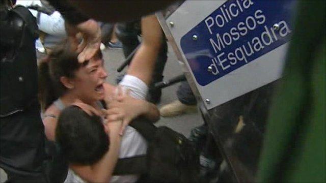 Police move protesters in Barcelona