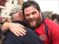 Man of the match John Brennan is embraced by his father after the game
