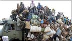 Ghanaian and Nigerian migrants fleeing Libya arrive in Agadez, Niger, on a truck - May 2011