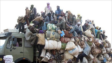 Ghanaian and Nigerian migrants fleeing Libya arrive in Agadez, Niger, on a truck - May 2011
