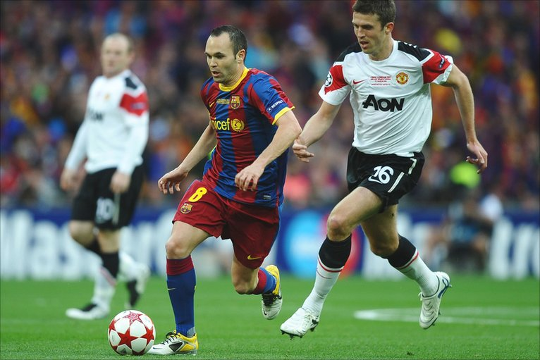 Iniesta runs away from Carrick