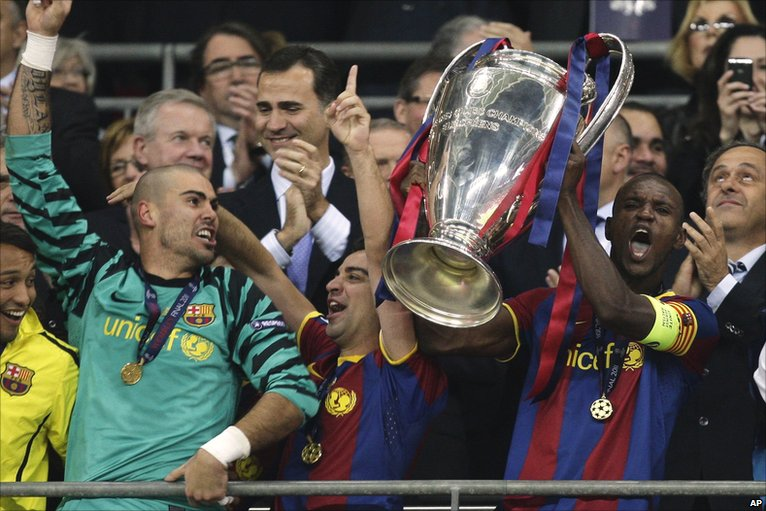 Abidal raises the winners' trophy