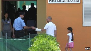 Maltese voters go to cast their vote in the referendum on 28 May 2011