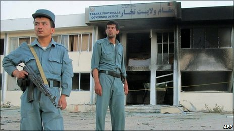 Afghan policemen outside Takhar provincial governor's office where Gen Daud was killed on 28 May 2011