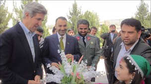 General Daud (centre, in uniform) with US Senator John Kerry (far left)