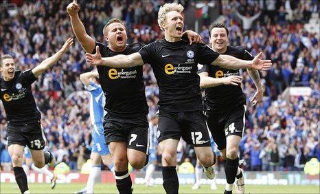 Craig Mackail-Smith celebrates his goal for Peterborough United