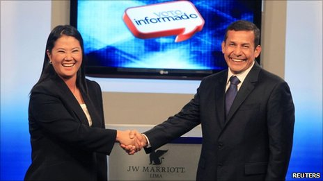 "Keko Fujimori (left) and Ollanta Humala (right) shake hands at the end of the presidential candidates"" debate in Lima, 29 May 2011"