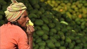 Man eats a mango