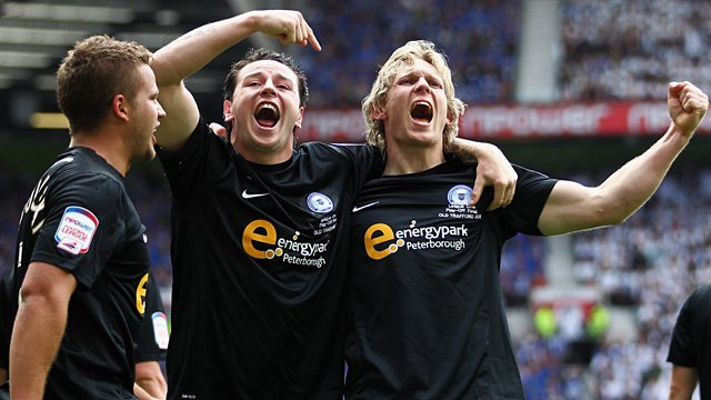 Peterborough's Lee Tomlin and Craig Mackail-Smith