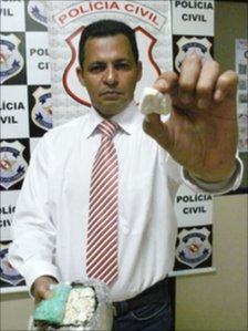 Police chief Ivanildo Santos holds a sample of oxi