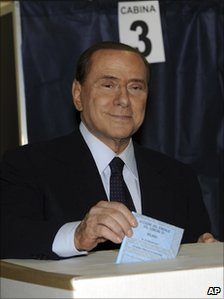 Italian Premier Silvio Berlusconi casts his ballot at a polling station in Milan, Italy, May 29, 2011