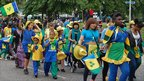 People carrying the flag of St Vincent and the Grenadines at the Reading Community Carnival 2011