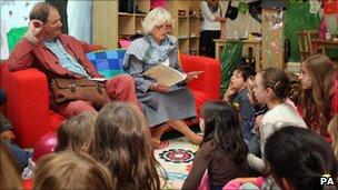 Michael Morpurgo listens as the Duchess of Cornwall tells a story