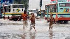 Boys in Dhaka play in flood waters