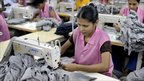 Women sew T-shirts in a Dhaka factory