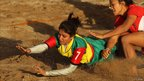A Bangladesh player dives for the line as she competes in the Asian Beach Games Oman 2010