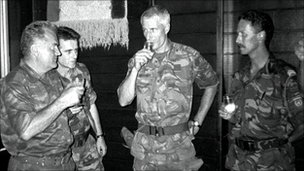 Lt Col Thom Karremans, centre, shares a toast with Ratko Mladic, left, on 12 July 1995
