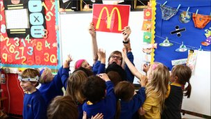 Alex Riley and schoolchildren