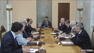 President Assad meeting officials - Sana news agency handout photo released 1 June