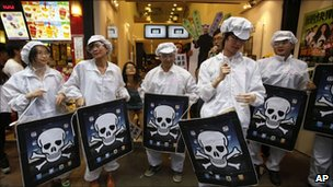 Protesters dressed as Foxconn workers demonstrate for better working conditions in Hong Kong