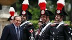 Italian PM Silvio Berlusconi (L) smiles as he waits for Russian President Dmitry Medvedev at Villa Doria Pamphili after a military parade to celebrate the 150th anniversary of unification of Italy, in Rome June 2, 2011