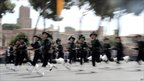 Soldiers run during a military parade to mark the anniversary of the founding of the Italian republic in 1946 and the 150th anniversary of Italian unification, 2 June 2011