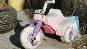Child's tricycle in the Garrido's back garden (28 August 2009)