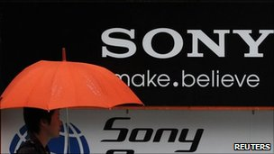 Man walks past Sony logo