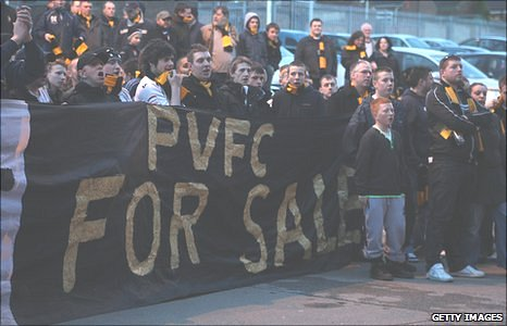 A group of Port Vale fans protest against the board