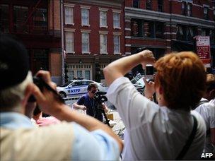 Tourists on Franklin St, where Dominique Strauss-Kahn is under house arrest in New York