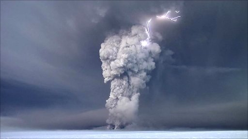 Lightening strikes as a volcano erupts