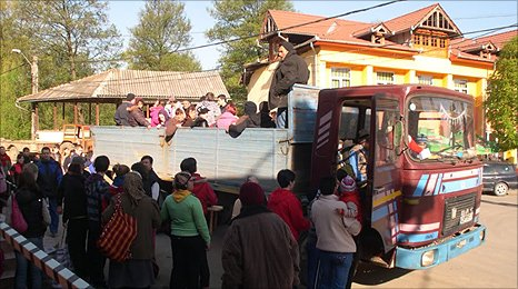 Boarding the truck in the village square