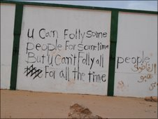 Graffiti on a broken wall inside the Katiba