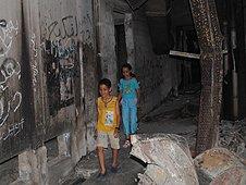 Children inspect the destruction at the Katiba army barracks