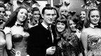 Hugh Hefner with London's Playboy bunnies in 1969