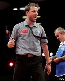 Paul Nicholson celebrates his victory over Phil Taylor at the UK Open