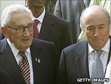 Kissinger (left) and Sepp Blatter (right)