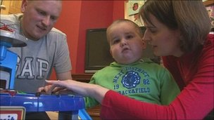 Ben Halford, with his parents Neil and Nicky in January 2010