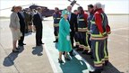 The Queen and Prince Philip with airport workers and firefighters