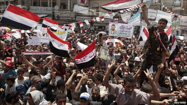 Anti-government protesters wave the national flag in Yemen
