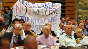 GMB members hold up banner saying Vince Cable &quot;not welcome&quot;