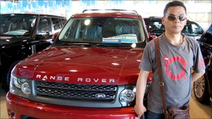 Li Hongquan with a Land Rover