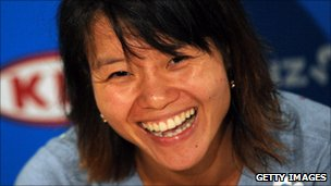 Li Na laughing during a press conference