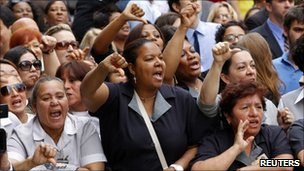 Hotel workers protest outside the New York court