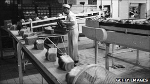 25th November 1965: A line of baked loaves ready to be packed at the Wonderloaf Bakery, Tottenham, north London.