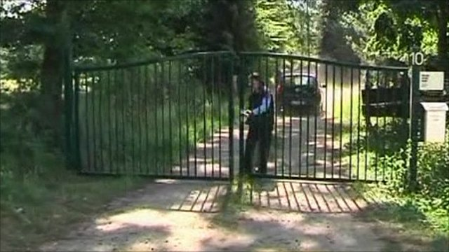 Security at gate of farm where tests are taking place
