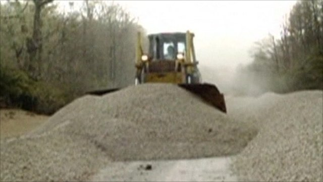 Bulldozer clearing ash