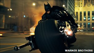Christian Bale is shown as Batman in a scene from The Dark Knight.